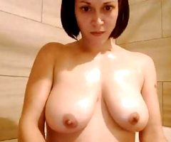 Large natural tits on showering MILF with shaven pussy, ass.