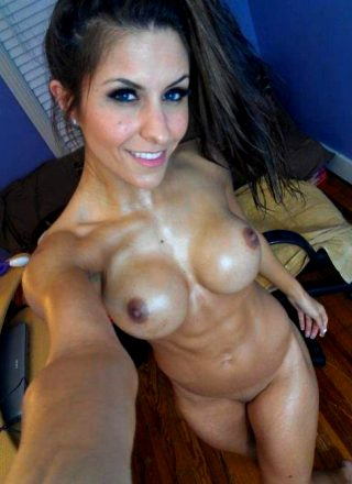 Fit Brunette Babe With Fake Tits Takes A Nude Selfie And Show Us Her Abs.