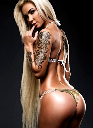 Her Hair Is As Impressive As Her Ink!