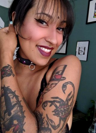 Love My Tattoos Or My Smile?