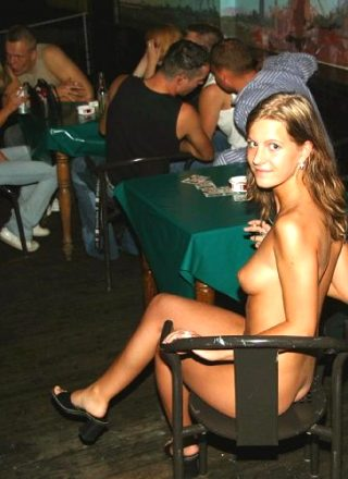 Naked Girl Sitting In A Bar
