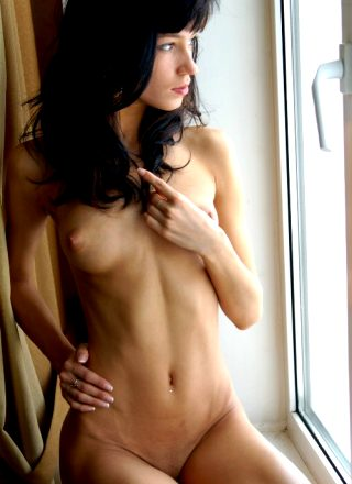 Raven Haired Beauty By The Window