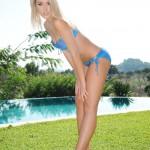 Charlotte Markham – Blue And Purple Bikini By The Pool - 1