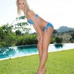 Charlotte Markham – Blue And Purple Bikini By The Pool - 2